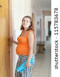 pregnant woman comes to the doctor at the clinic - stock photo