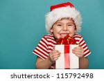 Smiling  Funny Child In Santa...