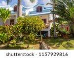 bungalow in the tropics.... | Shutterstock . vector #1157929816