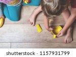broken yellow cup on the floor. ... | Shutterstock . vector #1157931799