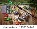 fishing rods and spinnings in... | Shutterstock . vector #1157934940