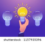 hand holds idea light bulb.... | Shutterstock .eps vector #1157935396