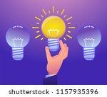 hand holds idea light bulb.... | Shutterstock .eps vector #1157935396