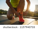 fitness woman runner tying... | Shutterstock . vector #1157940733