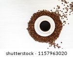 coffee cup and coffee beans on... | Shutterstock . vector #1157963020