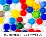plastic caps as background.... | Shutterstock . vector #1157995600
