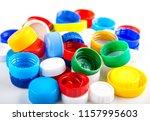plastic caps as background.... | Shutterstock . vector #1157995603