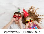 laughing girl and boy with... | Shutterstock . vector #1158022576
