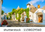 the traditional trulli houses... | Shutterstock . vector #1158029560