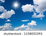 sun in bright blue sky.   Shutterstock . vector #1158052393