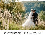 the bride and groom stand in... | Shutterstock . vector #1158079783