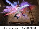 man jumps with colorful... | Shutterstock . vector #1158136003