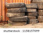 stack of used tires | Shutterstock . vector #1158157099