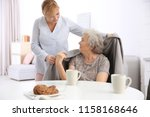 caregiver covering senior woman ... | Shutterstock . vector #1158168646