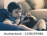 portrait of little boy having... | Shutterstock . vector #1158199486