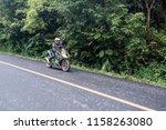 Small photo of Unidentified rider with motorcycle Kawasaki ninja 300 at Nan province, Thailand. 10 August 2018
