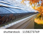 plastic guard over gutter on a... | Shutterstock . vector #1158273769