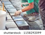 a workman's gloved hands use a... | Shutterstock . vector #1158292099