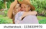 mature couple hugging in their... | Shutterstock . vector #1158339970