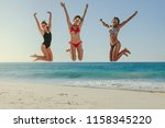 three women in bikini jumping... | Shutterstock . vector #1158345220
