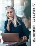 senior business woman listening ... | Shutterstock . vector #1158345640