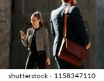businesswoman commuting to... | Shutterstock . vector #1158347110