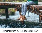 Boy Sits On The Wooden Bridge...