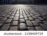 ancient old stone sett paving.  ... | Shutterstock . vector #1158409729