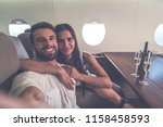couple on vacation  flying on... | Shutterstock . vector #1158458593