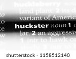 Small photo of huckster word in a dictionary. huckster concept.
