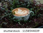 a cup of hot latte coffee cup | Shutterstock . vector #1158544039