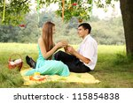 man gives a woman a box with a gift - stock photo