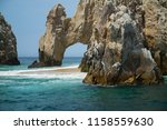Natural Stone Arch On A Beach...