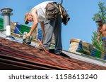 roofers working on replacing...   Shutterstock . vector #1158613240