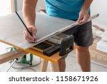 man hands marking tile to be... | Shutterstock . vector #1158671926
