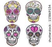 Mexican skull set. Colorful skulls with flower and heart ornamens. Sugar skulls.