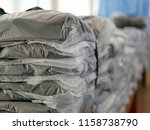 stacks of clothes packed in... | Shutterstock . vector #1158738790