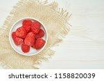 fresh red raspberry on wooden...   Shutterstock . vector #1158820039