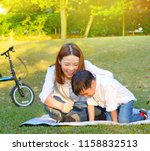 asian mother and son enjoyed... | Shutterstock . vector #1158832513
