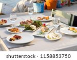 dishes with various seafood at... | Shutterstock . vector #1158853750