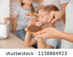 woman spreading chocolate paste ... | Shutterstock . vector #1158884923