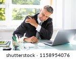 mature businessman suffering... | Shutterstock . vector #1158954076