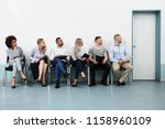 candidates sitting on chair... | Shutterstock . vector #1158960109