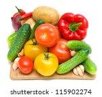 fresh vegetables on a cutting...   Shutterstock . vector #115902274