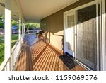 wrap around sunny porch with... | Shutterstock . vector #1159069576