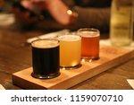 flight of craft beer trio on... | Shutterstock . vector #1159070710