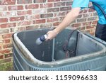 cleaning air conditioner... | Shutterstock . vector #1159096633