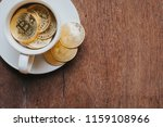 bitcoin in coffee cup   Shutterstock . vector #1159108966