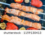 barbecue skewers with meat on... | Shutterstock . vector #1159130413