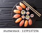 sushi rolls set served on black ... | Shutterstock . vector #1159137256